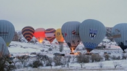 Hot air balloons and Cappadocia aerial view during winter