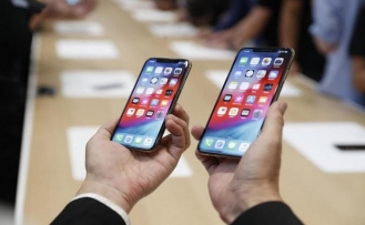 Apple unveils 3 new iPhones, smartwatch