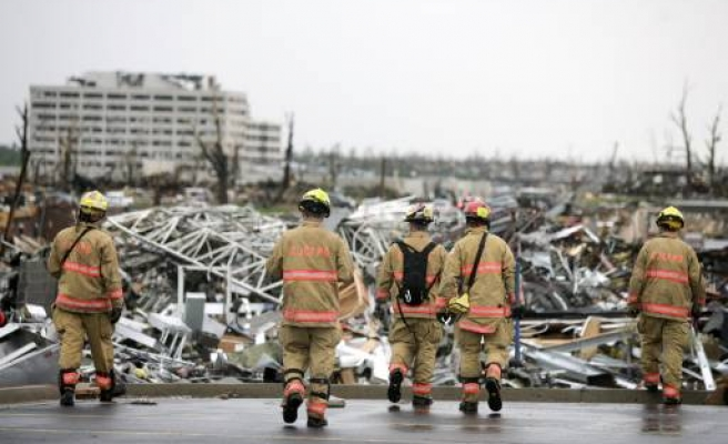 One reported dead as tornadoes hit US states