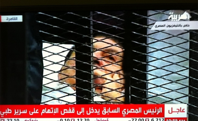 Egypt's Mubarak at court to face historic trial