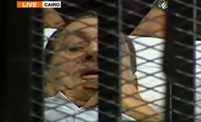 Egypt's Mubarak wheeled into court in bed for trial