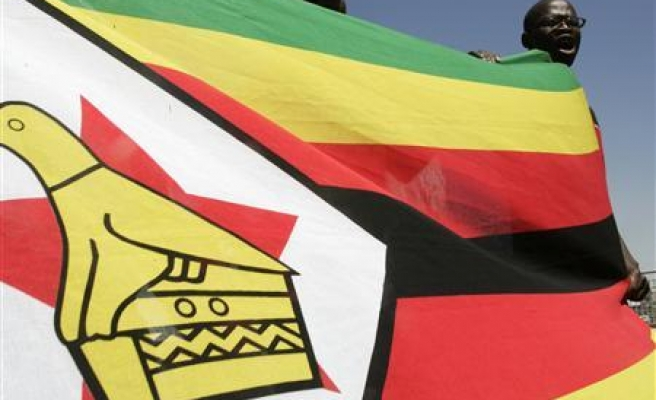 Zimbabwe PM challenges rivals to country's first TV debate