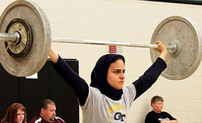 International weight-lifting federation frees headscarf in tournaments