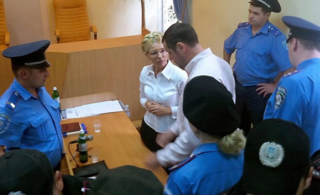 Former Ukraine PM Tymoshenko detained at trial