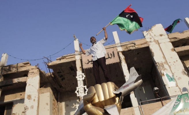 Libya opposition forces in Gaddafi's palace