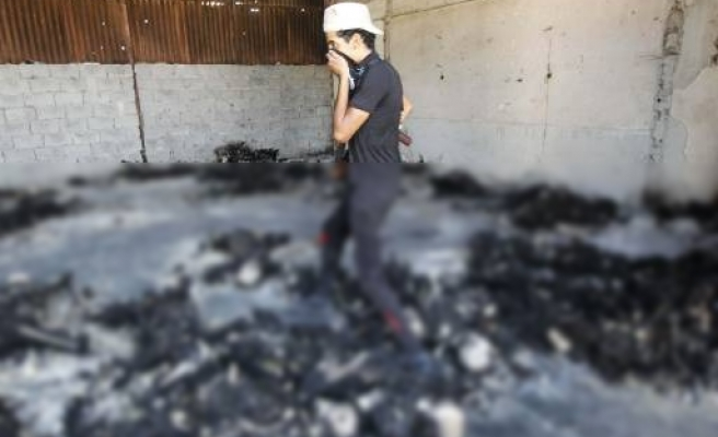 More than 50 bodies found in Tripoli warehouse: report