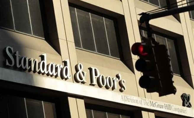 S&P cuts Italy one notch, outlook negative