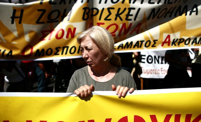 Greece adopts more austerity measures