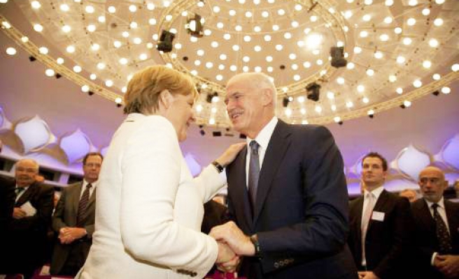 Greece to face inspectors, Merkel hints at bailout change