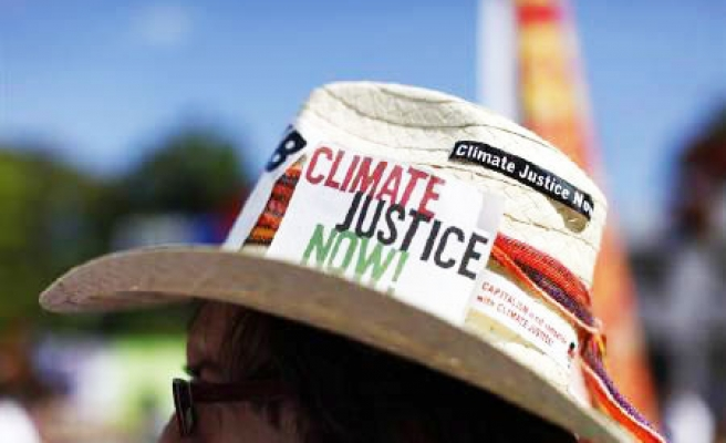 Tens of thousands crowd New York streets for climate march