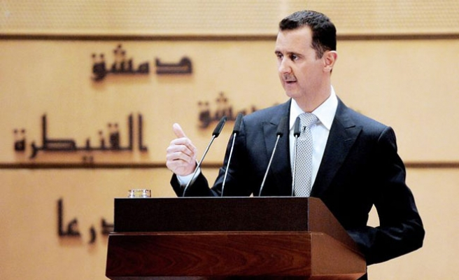 Assad says Syria war will be long, difficult -report