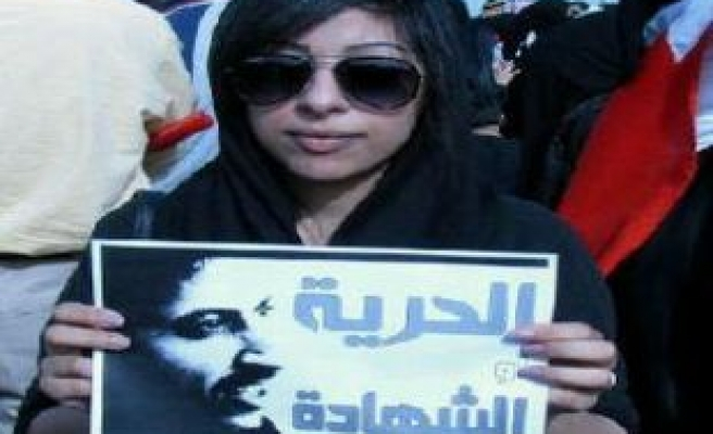 Bahraini activist jailed and fined for tearing up king's photo