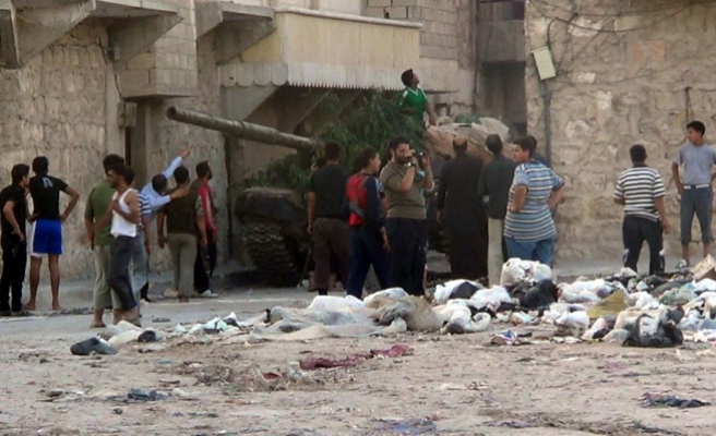Aleppo fighters vow to stand firm amid renewed bombardment