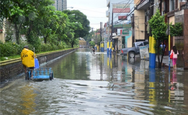 Philippines begins clean-up after monsoon rains kill scores