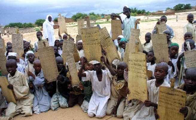Chad's students learning Quran from 'wooden tablets'