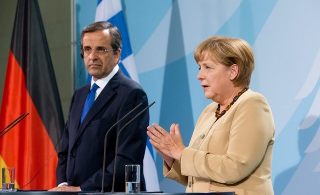 Merkel offers Greek PM no extra time on bailout
