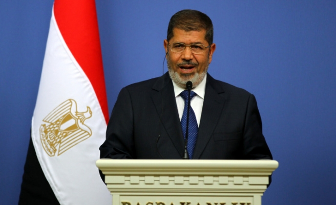 Egypt's Mursi due in Germany on shortened visit