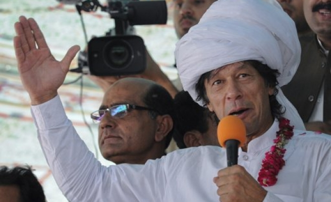 Imran Khan's party wins in Karachi, MQM protests