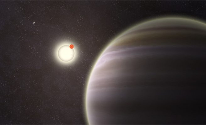 Astronomers find mini-planet in solar system's backyard