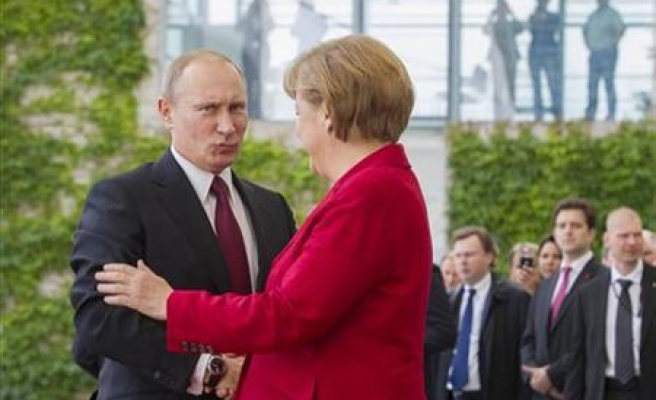 Merkel says Russia punishing countries for leaning towards EU