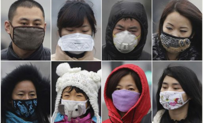 Beijing pollution shuts factories, removes cars