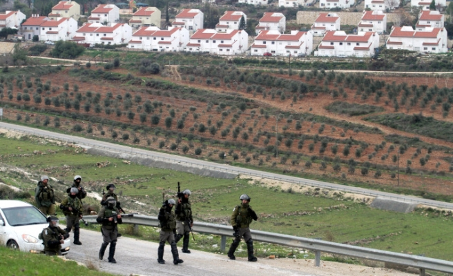 Israel troops teargas Palestinian activists, settlers shoot teen