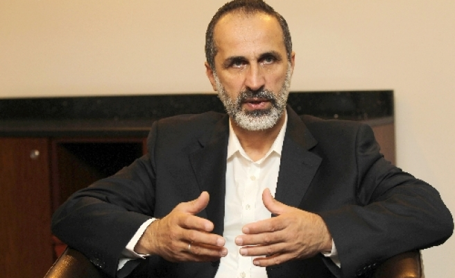 Syrian opposition leader ready to talk to Assad's deputy