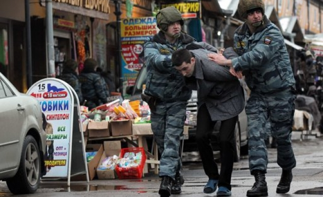 Russia holds hundreds of Muslims at market raids