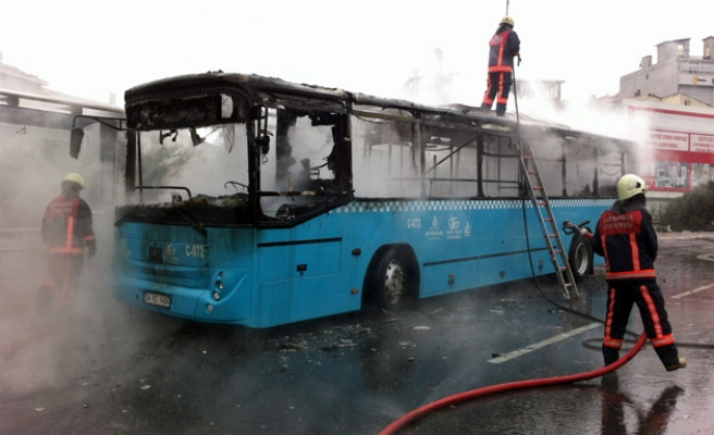 Two buses set ablaze after masked group throws molotov bomb