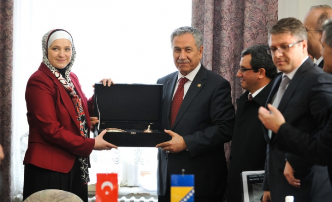 Turkish deputy PM visits Europe's first headscarf-wearing mayor