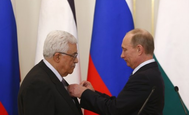 Russia's Putin gives Abbas state friendship medal