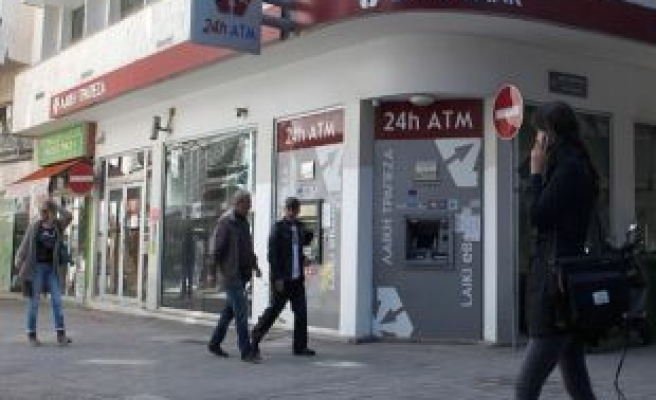 Cyprus partly eases capital controls
