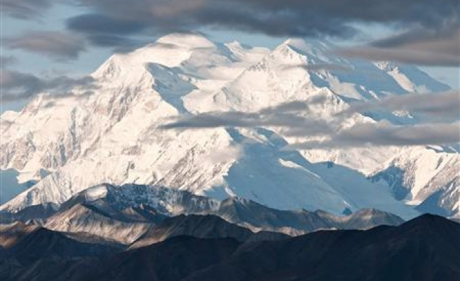 Century after peak first scaled, Alaska mountain's name still disputed