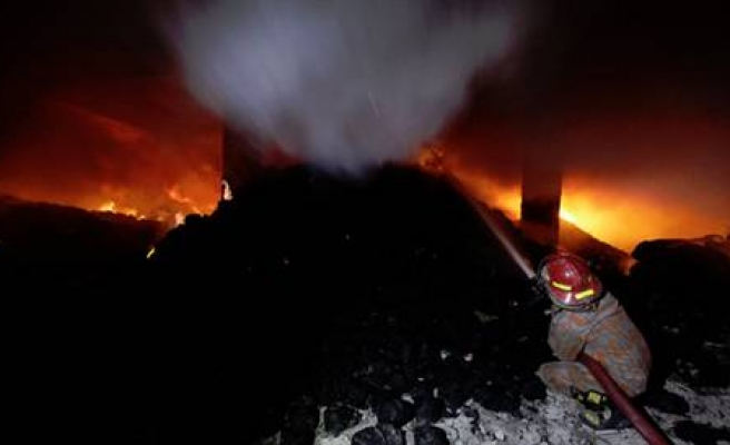 Bangladesh court orders action against factory owner in Nov fire