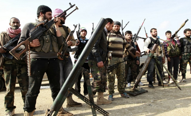 Six largest rebel factions unite in Syria