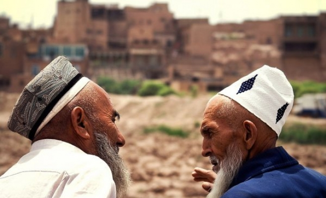 Chinese Muslims forced to spy on villagers
