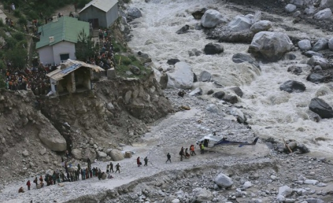 Nearly 6,000 missing a month after flash floods in India
