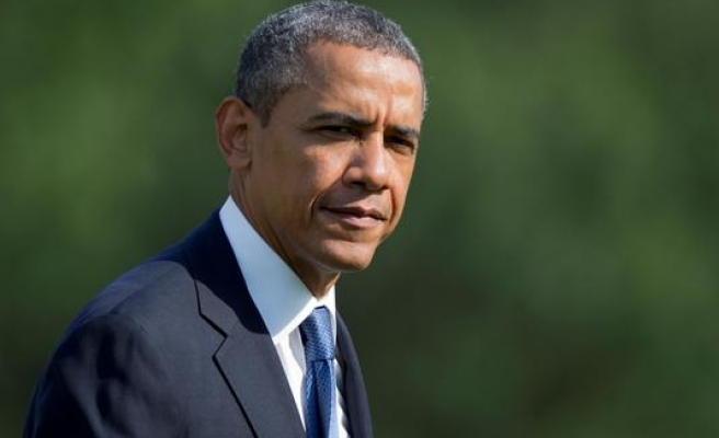 Obama signs bill to arm, train Syrian rebels