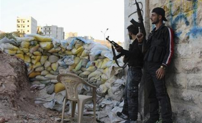 US to supply Syrian opposition with protective clothing