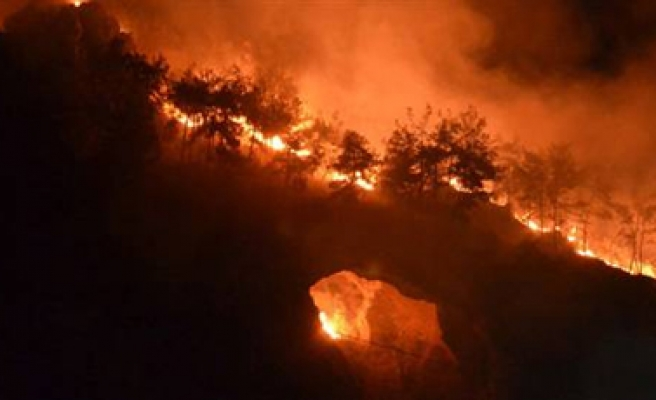 Firefighters work to contain fire near Turkey's Syria border