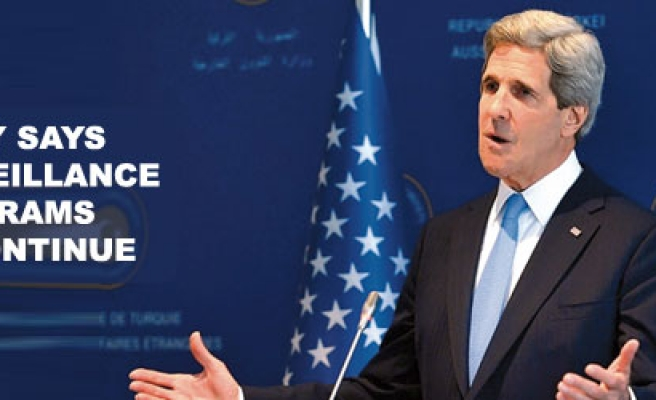 Kerry says US surveillance programs will continue