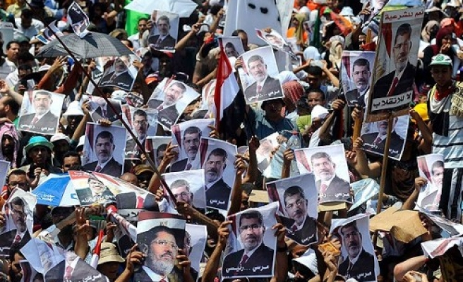 Pro-Morsi bloc calls for police, army club rallies