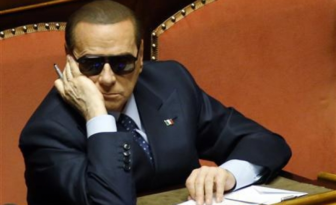 Berlusconi accused of bribing witnesses