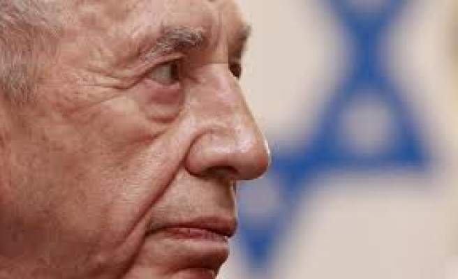 Israel's Peres warns against feud with U.S. over Iran