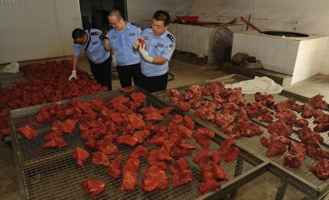 Muslims in China fed pork