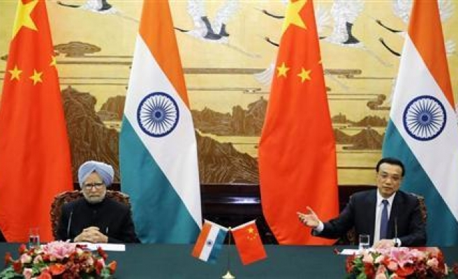 China, India sign deal aimed at soothing tension