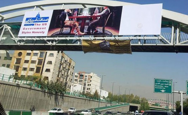 Iranian officials remove anti-American posters