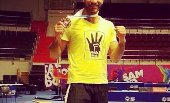 Egyptian kung fu player flashes Rabaa sign in Russia