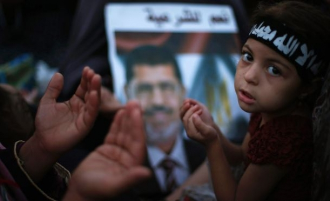 Defense team to meet Egypt ousted president in prison