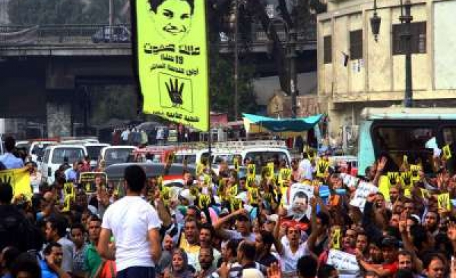 Egypt warns against attempts to break into Morsi trial